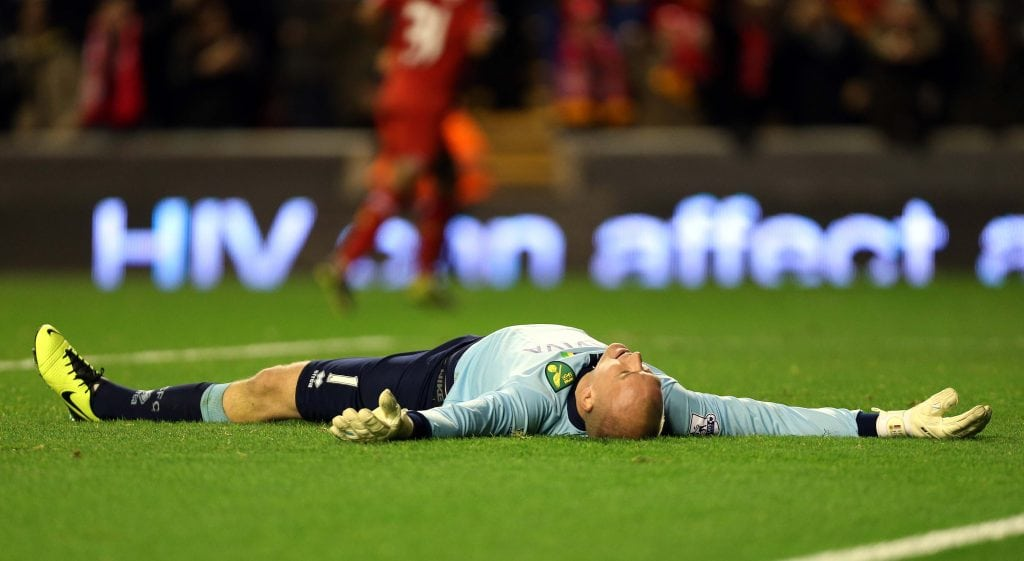 Norwich City's John Ruddy reacts after Liverpool's Luis Suarez scores his third during the Barclays Premier League match at Anfield, Liverpool. PRESS ASSOCIATION Photo. Picture date: Wednesday December 4, 2013. See PA story SOCCER Liverpool. Photo credit should read: Peter Byrne/PA Wire. RESTRICTIONS: Editorial use only. Maximum 45 images during a match. No video emulation or promotion as 'live'. No use in games, competitions, merchandise, betting or single club/player services. No use with unofficial audio, video, data, fixtures or club/league logos.